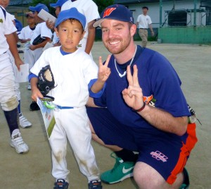 Thompson with a young participant at a baseball outreach clinic in Ishinomaki, a town in the northeast that was devastated by the tsunami.