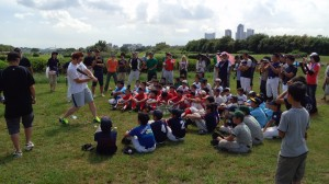 Professional Japanese baseball player Matt Murton teaching hitting at a baseball outreach clinic in Tokyo.
