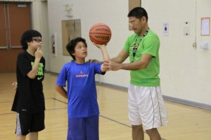 FCA Philippines coach Al Solis teaching a student at a basketball camp in the U.S.