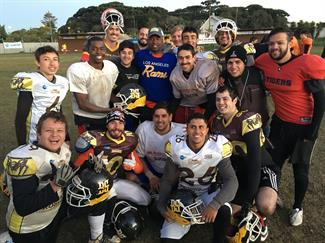 Southeast Coastal pic - Dexter Davis and American FB players in Brazil